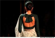 The Sabyasachi saree blouse made of green silk with a huge bow at the back. This was showcased at the 2012 PCJ Delhi Couture Week.