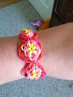 Daisy chain rubber band bracelet. This is an ADVANCED bracelet, if you haven't perfected a Starburst yet do not attempt to do this bracelet