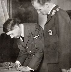 Reich Chancellery, on September The Fuhrer signed his appeal to the German people Heavy Cruiser, German People, Rare Photos, Ww2, World War, Poland, Winter Jackets, History, Biographies