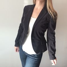 """Zara Basic Gray/Navy Blue Corduroy blazer Pre-owned, great condition, no holes or stains. This is a size small. I say it is """"gray-blue"""" because sometimes I look at it and think it looks like a dusty navy blue, and then other times I think it has a gray hue to it. I think it just depends on what color it's held against. Made of 98% Cotton/2% spandex. Lining is 100% polyester. Measurements: underarm to underarm flat across is approximately 17 inches. Back of neck to bottom of hem is…"""