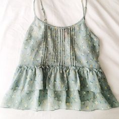 Light Blue Flowy Floral Cami Super lightweight and sheer but covers enough so a bandeau should be enough coverage! I've only worn a handful of time but simply isn't my style. Still in great condition! Size large but can fit medium as well! NO TRADES/USE OFFER BUTTON/NO HOLDS Forever 21 Tops Camisoles