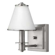 """Fredrick Ramond FR53230B Coco Bathroom Light  Part of the Coco Collection by Fredrick Ramond.  $90.00    The Coco collection features a sophisticated, timeless design with etched opal metal-trimmed glass shades.  •Tapered etched glass shade resembles a soft fabric feel.   •Multi-step raceway back plate.   Glass Etched Opal   Light Bulb (1)60w T4 G9 120v Halogen   Voltage 120 volt   Weight 5 Pounds   Width 5¾ inches    Projection 6½ inches    Height 9 inches    Back Plate 5.75"""" Width x 5""""…"""