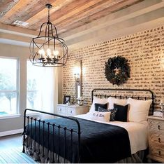 Love the brick wall in this bedroom. Love the wrought iron bed frame too. The ceilings are gorg too! What a fabulous bedroom this is! #farmhouse #bedroom #exposedbrick