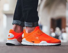 reputable site 10c2b 5f74d The Nike Sock Dart SE in Total Crimson is given a closer look. Find the  model at Nike retailers on Friday, May