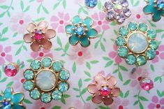 LOVE THIS!!!! Use cheap bling earrings (like these from Forever 21) as thumbtacks!!!