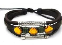 Beaded Three Strand Leather Bracelet with Orange Crystal Studs, Dark Green Hemp Wrap, Metallic Colored Spacers, and Metal Diamond Cut Tubes On Black Leather. Adjustable for Men, Women and Teens. (Foil Gift Box Included) . $18.95. Beaded Three Strand Leather Bracelet with Orange Crystal Studs, Dark Green Hemp Wrap, Metallic Colored Spacers, and Metal Diamond Cut Tubes On Black Leather.  Adjustable for Men, Women and Teens. (Foil Gift Box Included). Embellished with Orange Cryst...