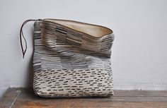 fold over clutch in natural linen with black lines
