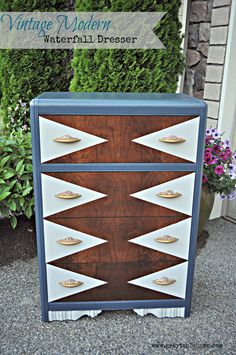 This vintage modern waterfall dresser was refinished in a geometric paint pattern and vintage art deco knobs.