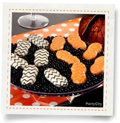 """""""Dipped & Decorated Cookies How-To"""" -- Pretty, upscale, and elegant chevron Nutter Butters displayed on licorice jelly beans."""