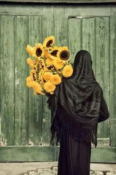 Europe | Woman with sunflowers, Portugal, 1993 |  © Bruno Barbey