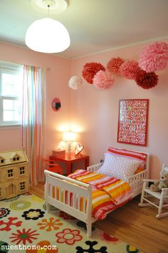 Pink and red girls room with pom poms. Lily's room. sueathome.com
