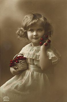 old tinted photo of little girl with a basket of cherries  #cerises  #cherries