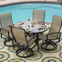 Perfect for soaking in the sun or just hanging by the pool, this 5-piece sling dining set dries quickly and is easy to clean with soap and w...