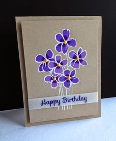 Three colors of purple on a white embossed kraft panel.  I stamped the sentiment on vellum with purple ink and clear embossed.  Added two shades of enamel dots in yellow.
