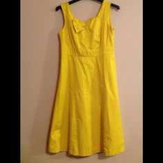 Yellow dress Great quality. Fully lined. Cotton/nylon blend. Length is 40, chest 17, and waist 16. Worn a few time but still in great condition. Made in Vietnam. Merona Dresses