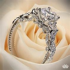 18k white gold Verragio braided 3 stone engagement ring.
