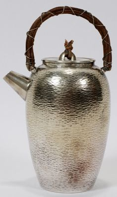 "HAMMERED SILVER TEAPOT, H 6"" TO THE HANDLE:Japanese aesthetic, ovoid shape with hammered surface, a removable cover, and wrapped bamboo hand..."