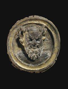A GREEK PARCEL GILT SILVER PHALERA - BACTRIA, CIRCA 3RD CENTURY B.C.