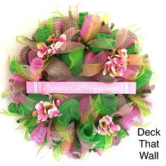 This vibrant wreath is made with three different colors of mesh, featuring light pink deluxe, green deluxe, and light pink with lime premium!  There are two dif