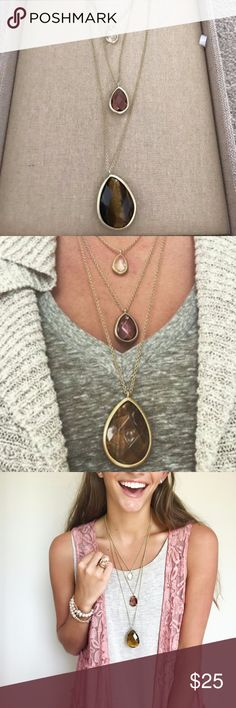 """Three Row Convertible Necklace Layer up this season in our signature 3-in-1 convertible style, now in Fall's favorite new hues + worn 12k gold plating. Centered by semi-precious tiger eye paired with light rose + clear glass, these perfectly positioned pendants are infinitely wearable, as they can be layered all together or styled one-by-one! worn 12k gold-plated nickel-free plating 16"""", 20"""" + 26"""" approx. length + 2"""" extender lobster clasp semi-precious tiger eye, light rose + clear glass…"""