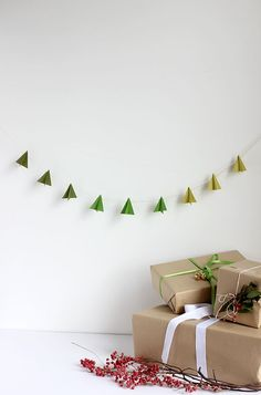 A modern take on Christmas decorations. DIY: Modern Paper-Tree Garland