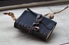 Rustic hand sewn leather travel journal by SpinningGears on Etsy