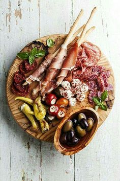 An antipasto platter balances savory and salty flavors; try pairing marinated The post An antipasto platter balances savory and salty flavors; try pairing marinated appeared first on Tasty Recipes. Italian Food Near Me, Italian Food Restaurant, Italian Restaurants, Aperitivos Finger Food, Antipasto Platter, Meat Platter, Tapas Platter, Antipasta Platter Ideas, Platter Board