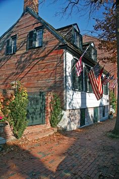 "Colonial Architecture in Alexandria, Virginia - ""One of Alexandria's earliest houses, built around 1775, awaits paint on likely original wide side boards."""