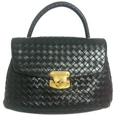 e53e816588 View this item and discover similar top handle bags for sale at - Vintage  Bottega Veneta classic black lamb leather intrecciato handbag.