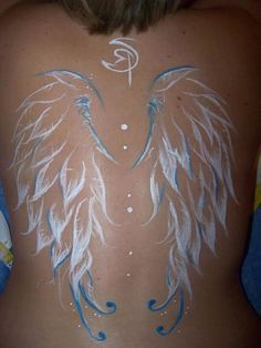 I actually love the way these wings are and typically I don't like the white ink look, but with the blue accent it just seems to pop. Make these smaller and I'd consider this being the wings I want. Feather Tattoos, Body Art Tattoos, Tatoos, Ear Tattoos, Tattoo Art, Pretty Tattoos, Beautiful Tattoos, Awesome Tattoos, Symbolic Tattoos