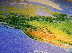 """49-year-old Chris Chamberlain, an IT worker from London, England, spent the last two years of his life piecing together the """"Jewel of the Universe"""", a giant mosaic of Earth made with 330,000 hand-cut pieces of stained glass, each smaller than a fingernail."""