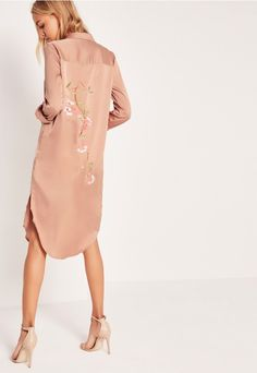 Get your bedroom eyes on, slip into this shirt dress for a hit of romantic luxe and take to the streets in this nightwear-esque piece. In a toffee nude hue, Japanese inspired back embroidery, shirt style, sweet satin feel and roll up sleeve...