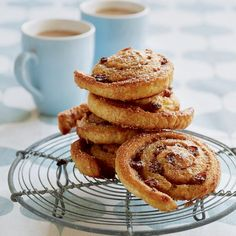 This classic cinnamon and raisin swirls recipe uses home-made Danish pastry dough, though you can buy puff pastry if you're short of time.