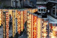 Poles decorated with kimono fabric patterns illuminate Arashiyama Station on the Arashiyama Line in Kyoto's Ukyo Ward. Designed by Yasumichi Morita.