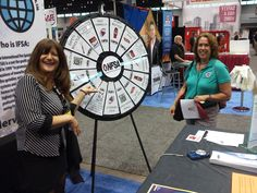 NFSA marketing manager Joanne Genadio mans the prize wheel at the NFSA booth at the NFPA exhibition  in Chicago. Buy this Prize Wheel at http://PrizeWheel.com/products/floor-prize-wheels/big-40-prize-wheel/.