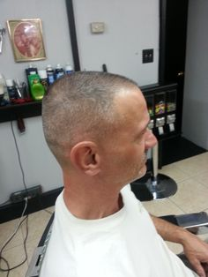 Low Skin Fade with a 2 on top.