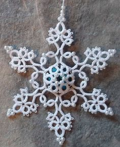 """Favorite Number 17 from, """"Festive Tatting."""" I added a button to the middle. Shuttle Tatting Patterns, Needle Tatting Patterns, Tatting Jewelry, Tatting Lace, Drops Patterns, Lace Patterns, Tatting Tutorial, Crystal Snowflakes, Vintage Sewing Machines"""