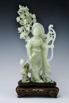 "Chinese Jade Figurine of Mulan : Silver wired wood base, depicting female warrior Mulan, 20th century, measures 9""h 4""w"