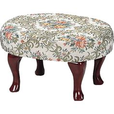 Create a space of relaxation in your home with this floral upholstered foot stool. With cherry finished Queen Anne legs and a vintage floral pattern, this charming footstool will add the perfect finis