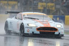 Google Image Result for http://image.motortrend.com/f/motorsports/gulf-livery-aston-martins-test-in-preparation-for-le-mans/9919426%2Bcr1%2Bre0%2Bar1/aston-martin-dbr9-on-wet-track.jpg