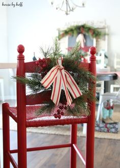 Red spray painted chair decorated with greens and red white striped ribbon.  So cute!!   My Christmas Home Tour with Country Living - House by Hoff