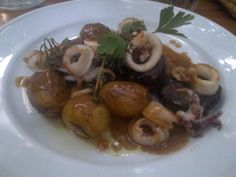Delicious grilled blood sausage slices with calamari and chili @ Restaurant Stomach