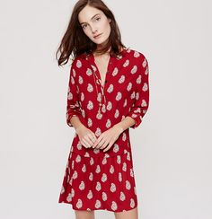 """Fantastically fluid, this shirtdress refreshes with a swingy finish. Round neck. Long sleeves with button cuffs. Hidden front button placket. Drop waist. Shirred beneath back yoke. 19 1/4"""" from natural waist."""