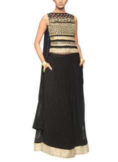 Look classy and sophisticated in any Anita Dongre number from strandofsilk.com. This gown-like top and long flared skirt set is adorned with dazzling parallel patterns and a golden zari border. Black and gold combinations are truly timeless and flawless #anitadongre #blackandgold #flaredskirt #zari #embroidery #classy #sophisticated