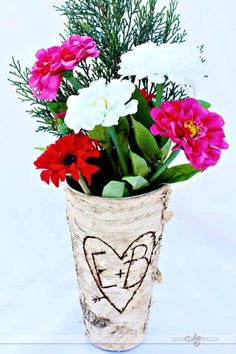 Check out this darling vase.  Can you believe it only cost  $5?  Then she just added their initials with a wood burner.   Sounds EASY!