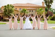 Beautiful blush pink modest lace bridesmaid dresses by Dainty Jewell's Modest Apparel. Photo: Anatoly Pislar | Romance Photography