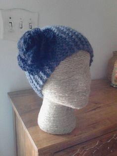 Light gray knit ear warmer with dark gray rose done by Jodi Villanella.