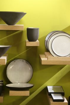 These wooden shelves are amazing!  Black and white crockery by Diane Ferreira.