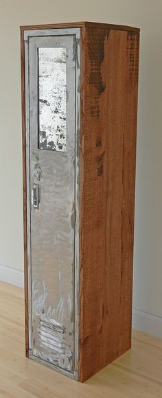 reclaimed locker with a plasma cutout for an antiqued mirror