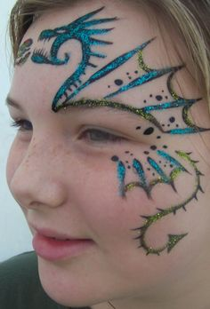 When you think about face painting designs, you probably think about simple kids face painting designs. Many people do not realize that face painting designs go beyond the basic and simple shapes that we see on small children. Facial Painting, Dragon Face Painting, Face Painting For Boys, Face Painting Designs, Paint Designs, Body Painting, Simple Face Painting, Looks Halloween, Halloween Makeup